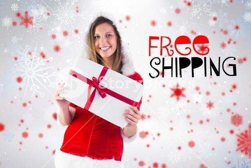 Composite image of pretty santa girl holding gift