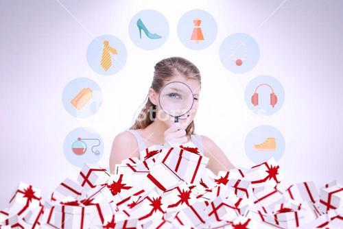 Composite image of woman looking through a magnifying glass