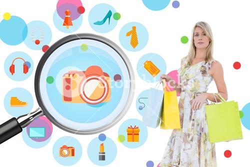 Composite image of elegant blonde with shopping bags