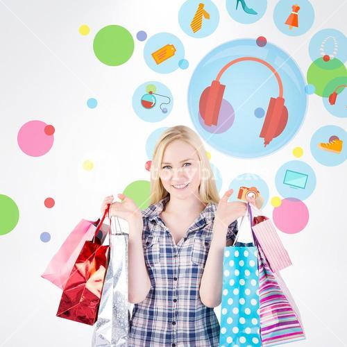 Composite image of pretty young blonde holding shopping bags