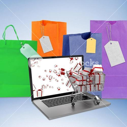 Composite image of trolley full of gifts on laptop