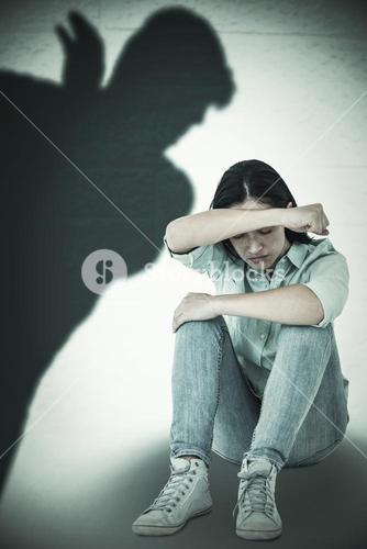 Composite image of sad woman sitting on the floor and hiding her face