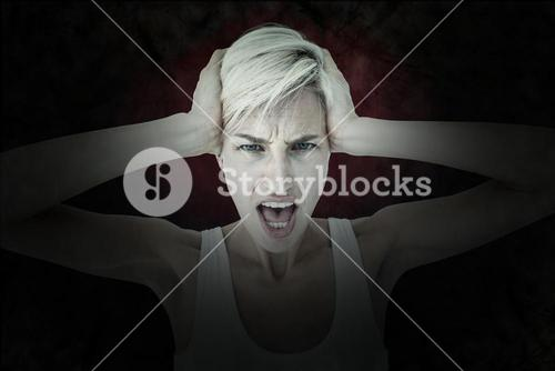 Composite image of angry woman screaming and holding her head