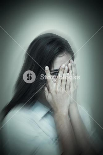 Composite image of portrait of woman peeking through fingers