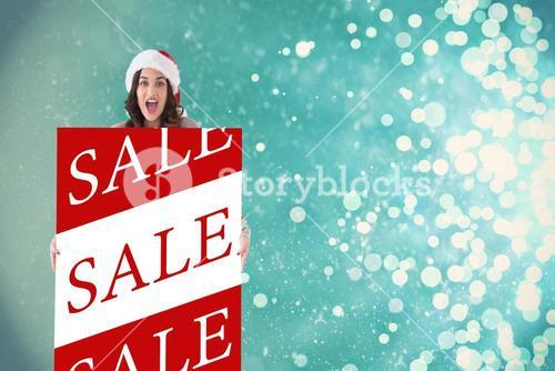 Composite image of happy brunette in santa hat showing white poster