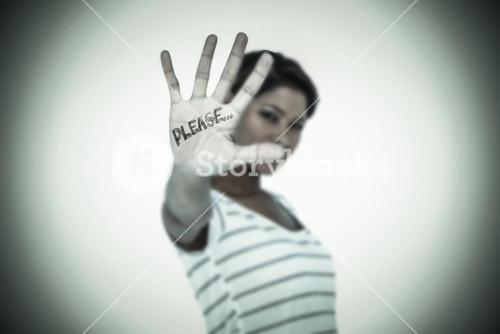 Composite image of serious woman making stop sign over white background