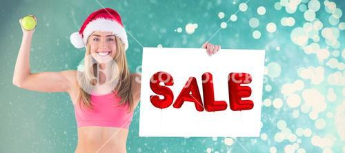 Composite image of festive fit blonde showing poster