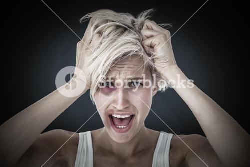 Composite image of stressed woman screaming and holding her head
