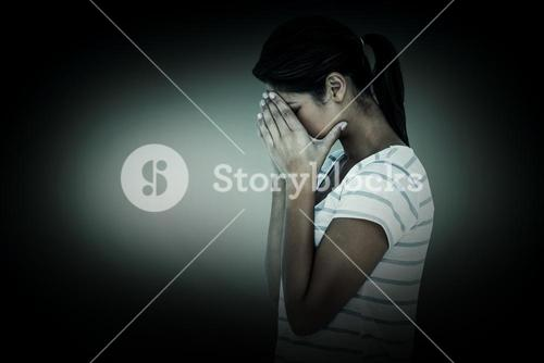 Composite image of side view of upset woman covering face