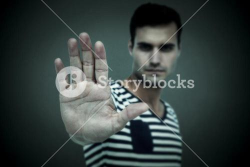 Composite image of portrait of serious man making stop sign