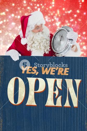 Composite image of santa holding a clock and sign