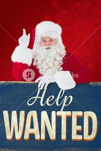 Composite image of smiling santa claus doing a gesture