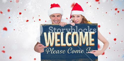 Composite image of festive couple showing a poster