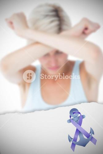 Composite image of upset woman holding her arms in front of her head