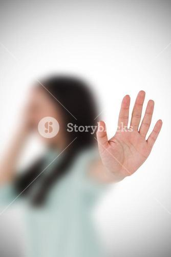 Composite image of irritated woman showing her hand