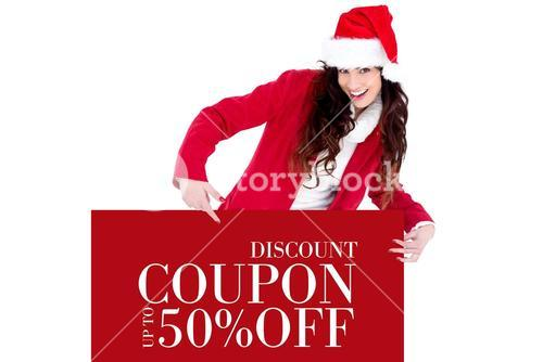 Composite image of festive brunette pointing white poster
