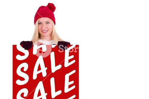 Composite image of festive blonde showing a red poster