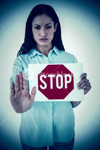 Composite image of woman showing card and saying stop