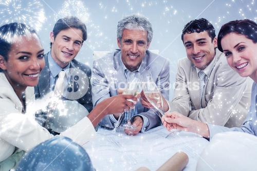 Composite image of smiling architectutal team celebrating a success with champagne