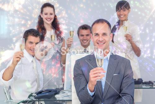 Composite image of successful business coworkers toasting with champagne
