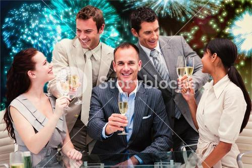 Composite image of smiling business team celebrating a success with champagne
