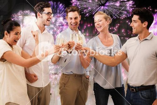 Composite image of casual business team celebrating with champagne