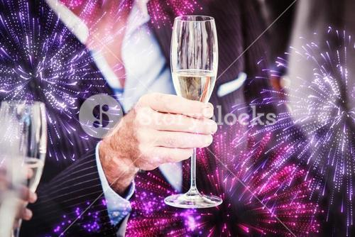Composite image of close up of a senior businessman holding a glass of champagne