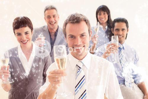 Composite image of international business people toasting with champagne