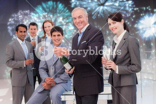Composite image of businessman opening a bottle of champagne to celebrate a success