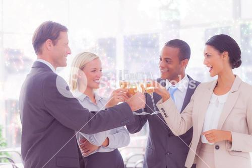 Composite image of business team celebrating with champagne and toasting