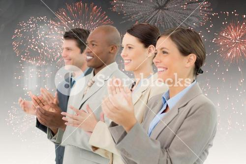 Composite image of side view of clapping sales team standing together