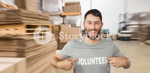 Composite image of man showing volunteer text on tshirt