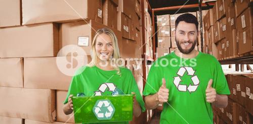Composite image of portrait of cheerful volunteers in recycling symbol tshirts