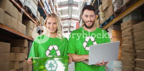 Composite image of portrait of smiling volunteers in recycling symbol tshirts