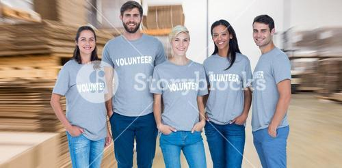 Composite image of volunteers friends smiling at the camera