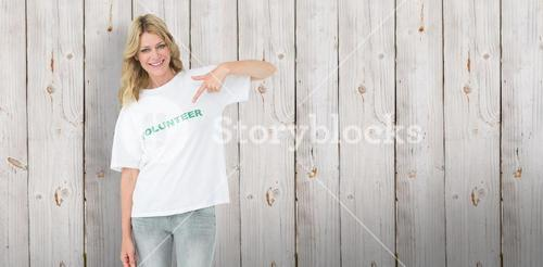 Composite image of portrait of a happy female volunteer pointing to herself