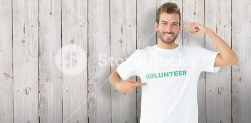 Composite image of portrait of a happy male volunteer pointing to himself