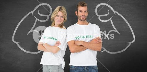 Composite image of portrait of two happy volunteers with hands crossed