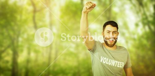 Composite image of portrait of cheerful volunteer