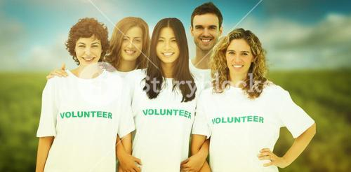 Composite image of group of people wearing volunteer tshirt
