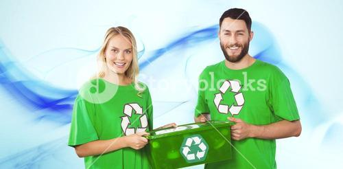 Composite image of portrait of smiling volunteers carrying recycling container