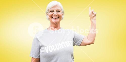 Composite image of happy volunteer grandmother with thumbs up