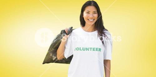 Composite image of team of volunteers picking up litter in park
