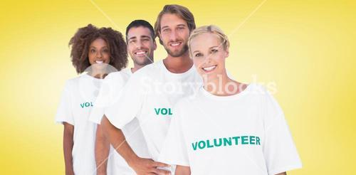 Composite image of smiling volunteer group
