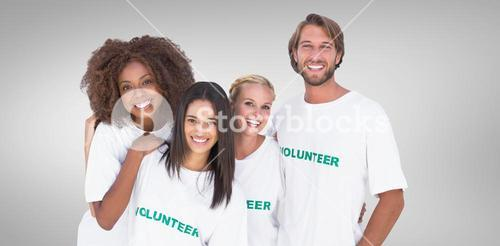 Composite image of smiling group of volunteers