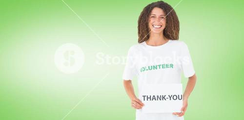 Composite image of smiling volunteer showing a thank you poster