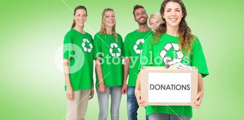 Composite image of people in recycling symbol tshirts with donation box