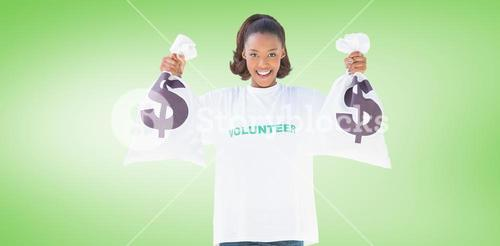 Composite image of smiling volunteer woman holding money bags