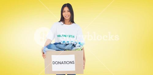 Composite image of happy woman carrying donation box