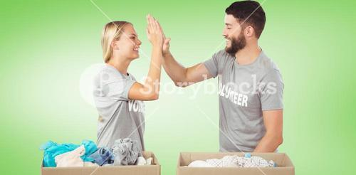 Composite image of happy volunteer doing high five